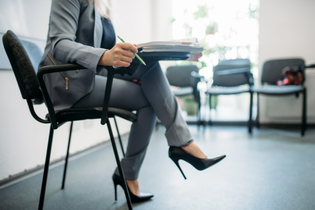 Woman passes interview in office, head hunting