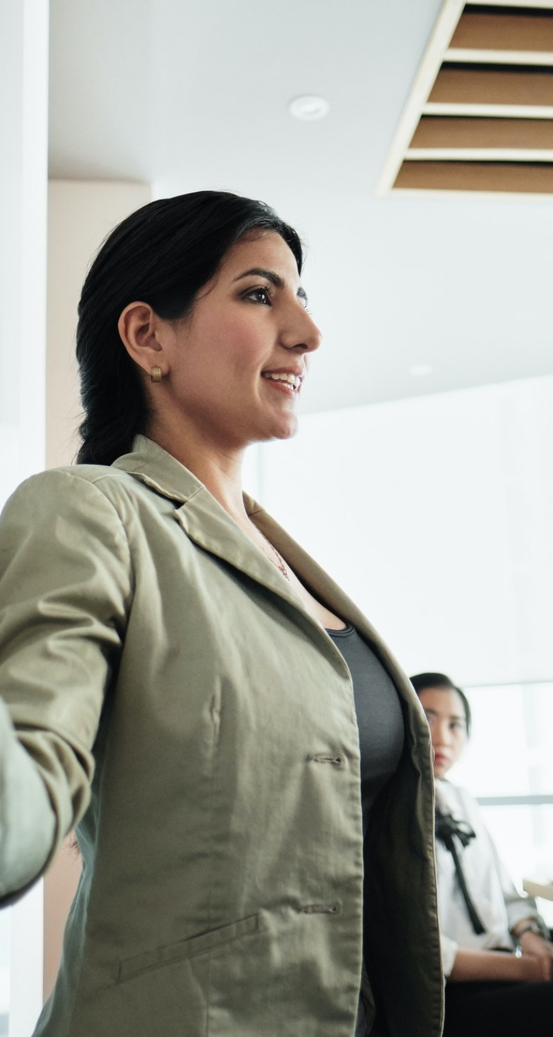 Woman Doing Presentation With Board In Office Meeting Room